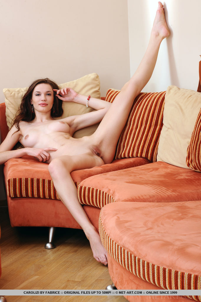 skinny tiny! slim young naked chick posing naked on the sofa. she is